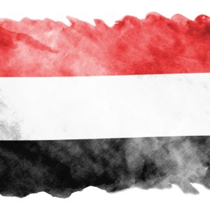 Yemen flag is depicted in liquid watercolor style isolated on white background